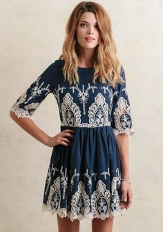 Romantic and darling, this Aegean blue-hued dress is adorned with an allover white lace design and intricate embroidered detailing. Finished with a rounded neckline and a hidden back zipper, this...