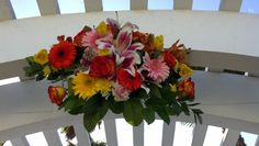 Colorful arch arrangement by Pamela for Michael's Flower Girl
