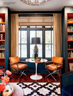 Nook, bookcases flanking window...with curtains in between. good colors and patterns, too.