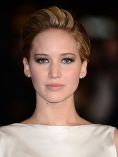 For the London Catching Fire premiere, J Law went for a deep part on her left side - and pumped up the volume, combing over and teasing the rest of her tresses.CELEBRITIES AT WINTER WONDERLANDBEST DRESSED CELEBS OF THE WEEKJEN LAWRENCE IS A BARE-FACED BEAUTY IN NEW DIOR CAMPAIGN  -Cosmopolitan.co.uk