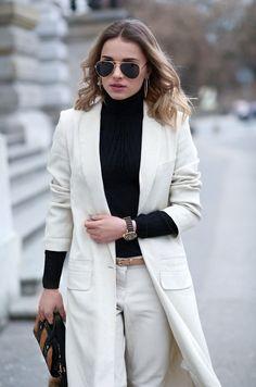 fot. Michał Wilczewski black coat Aryton /shoes Kazar / bag Parfois /glassesRayBan /golf Reserved /coat H&M / pants H&M Studio