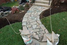 Laying a Flagstone Walkway Yes another step-by-step on our road to a good solid, durable flagstone pathway.