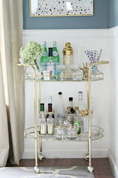 Love the bar cart and blue walls + khaki. looks very neat and polished!