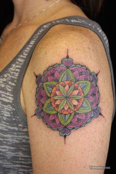 "The colors and patterns of this mandala tattoo create a floral effect. Mandalas are sometimes known as ""flowers of life"", symbolizing the blossoming of life as time progresses. [source]"