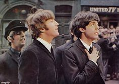 """Ringo, John and Paul during the filming of A Hard Day's Night, 1964.  Scanned from """"The Beatles Film"""" souvenir magazine (1964)."""