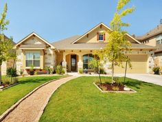 Calm, yellow exterior with gravel walk to front door 1807 Pradera Path, Leander Texas 78641