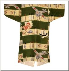 Japanese baby boy's kimono with planes and bombs, rayon, circa 1937. This tiny garment was exhibited in the Fall of 2012 in the Museum of Modern Art's show, Century of the Child, Growing by Design 1900-2000.  Norman Brosterman Propaganda Kimono Collection.