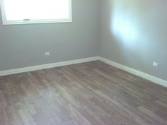 Here's a pic of the Lowe's Porcelain Hardwood tile fully installed.  Looks great.