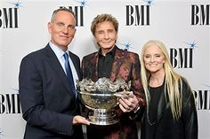 BMI President and CEO Michael O'Neill, 2017 BMI Icon Award recipient Barry Manilow and BMI vice president and general manager, writer/publisher relations Barbara Cane at the Broadcast Music, Inc (BMI) honors Barry Manilow at the 65th Annual BMI Pop Awards on May 9, 2017 in Los Angeles, California.