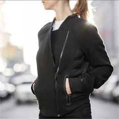 Nike Tech Fleece Black Bomber Jacket •Cold-weather comfort meets high style in the Nike Tech Fleece Aeroloft Moto Women's Jacket, made with breathable insulation and engineered fleece for optimal warmth with a modern, motorcycle-inspired look. Rounded hem for a flattering fit. Fabric: Body/lining: 64% cotton/36% polyester. Panels/lining: 100% polyester. Fill: Minimum 90% goose down. •Bomber style fit, true to size. •New with tag. •NO TRADES/PAYPAL/MERC/VINTED/NONSENSE. •PLEASE USE OFFE...