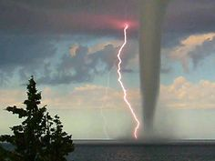 Incredible shot captured a huge waterspout and lightning at the same time, taken at Adriatic sea, Croatia.