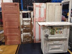 Craft show booth set up. Back wall of vintage doors hinged together. Customer checkout stand made from salvaged doors. ,shelves in back for customer bags and cash drawer. best part is the stand is on casters for easy unloading. Junk Chic 5280