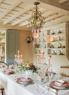Pretty in pink and white, this cottage dining room shows off its credentials with this perfectly formed table arrangement . . .