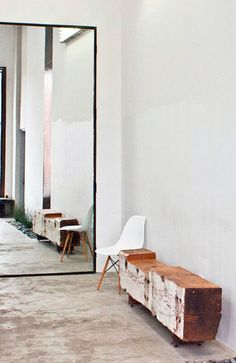 Mirror + wood bench + concrete floor |= make an entrance
