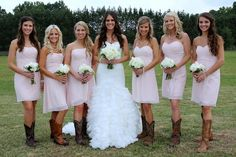Love these bridesmaids dresses in light pink with cowboy boots! Very fitting for the venue, Vintage Oaks Farms in Watkinsville, GA. Blane Marable Photography.