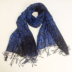 """Royal blue leopard print scarf This scarf is royal blue with brown and black leopard print. The ends have fringe detail. Worn only once. Has only one small snag as shown in picture, but only noticeable if held up to bright light. Measures 21"""" wide, 68"""" long. ❗️ Open to offers ❗️ Accessories Scarves & Wraps"""