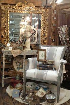 Lovely display... Love the grain sack upholstered chair