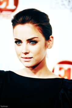 jessica stroup. short hair pulled back with a little bump.