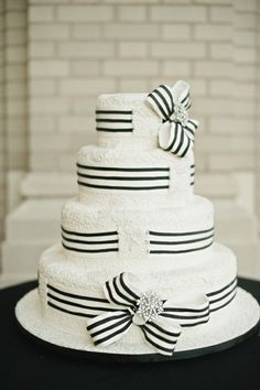 White wedding cake with black and white ribbon