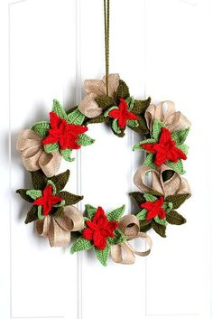 Crochet Christmas ... by YarnTwist | Crocheting Pattern - Looking for your next project? You're going to love Crochet Christmas Poinsettia Wreath by designer YarnTwist. - via @Craftsy