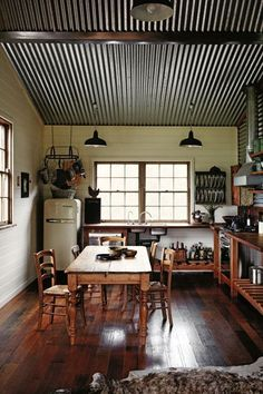 Simple and effective. Great ideas for a #kitchen remodel! #corrugated #metal ceiling <3