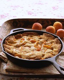 Cobbler is a fruit dessert with a thick top layer of crust. In this version of the classic, spiced apricot wedges are arranged atop a toasted-almond batter. Baking puffs up the cake, so only bits of fruit peek through.