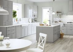 IKEA A large grey country kitchen with a lot of drawers, wall cabinets and a kitchen island. Ikea Kitchen Design, Kitchen Colors, Kitchen Layout, Kitchen Interior, Kitchen Decor, Kitchen Ideas, Kitchen Designs, Large Kitchen Design, Ikea Bodbyn Kitchen