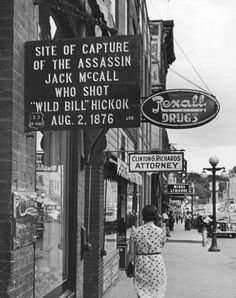 "Street sign in Deadwood, South Dakota, ""Site of Capture of the Assassin Jack McCall Who Shot ""Wild Bill"" Hickok aug. 2, 1876"" (1940)"