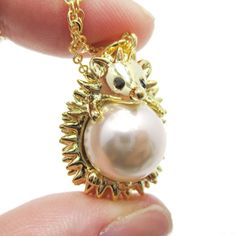 - Details - Sizing An adorable animal inspired necklace featuring a 3D pendant in the shape of a small hedgehog wrapped around a pearl in gold! Store FAQ | Shipping Info | Returns & Exchanges Size: Th