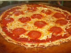Coconut Flour Pizza Crust :http://lowcarbyum.com/coconut-flour-pizza-crust-or-bread-sticks/