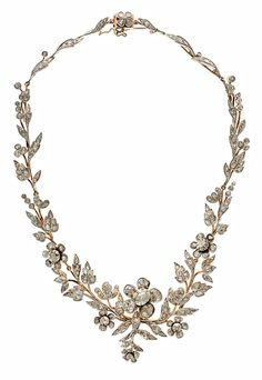 A vintage rose gold, silver and diamond necklace, by Luis Masriera, 1920-1930. The central piece can be worn as a brooch. #Masriera #necklace #vintage