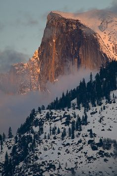 Winter Sunset on Half Dome Yosemite National Park, California,. (Travel This World) Places To Travel, Places To See, Winter Sunset, Winter Snow, Parcs, Beautiful Landscapes, The Great Outdoors, Wonders Of The World, Grand Canyon
