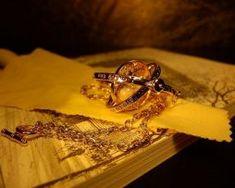 Luxusný zlatý náhrdelník s príveskom času, Obracadlo,
