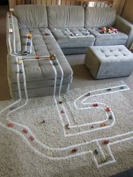 Masking tape race track- plus she describes a cute idea to make a figure 8 on the back of a shirt so you can lay down and get a back rub while the kids drive on you.