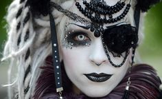 """A visitor of a Wave-Gothic meeting poses for a photo on May 17 in Leipzig, eastern Germany. Organizers expect some 20,000 visitors from all over the world for the """"dark"""" music and arts festival running until May 20. (Hendrik Schmidt/DPA via AFP/Getty Images)"""