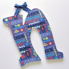 Decoupage letters for wall (would spell out child's name) Use scrapbooking paper