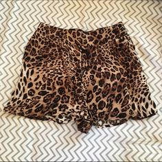 Cheetah Shorts Cheetah print shorts with elastic back waist band. Great condition- only used twice. Charlotte Russe Shorts