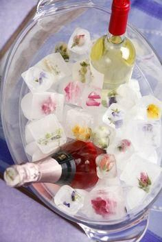 Freeze flowers in ice cubes for a pop of color in a beverage tub.