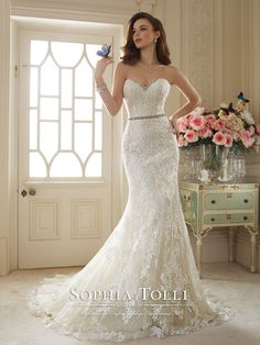 Designer Wedding Dresses from 2016 - Sophie Tolli - Style No. » Y11649 – Kenley Strapless misty tulle, diamond tulle and allover lace sheath with lace appliqués, sweetheart neckline encrusted with hand-beaded crystal appliqués, detachable crystal beaded belt at natural waist, back corset, chapel length train. Removable spaghetti and halter straps included. Also available with a back zipper as style Y11649ZB. Sizes: 0 – 28 Colors: Gold/Ivory, Ivory, White