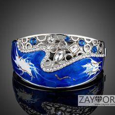 Rhodium Plated Unique Design Luxury Crystal Blue Stellux Austrian Oil Painting Pattern Bangle/Bracelet (BNB-009)  Price: Rs. 2925/- www.zayvor.com Sales@zayvor.com Call/whatsApp: 92-303-4255194  #zayvor #bracelets #bangles #jewellery #jewelerydesign #jewelry #fashion #style #womensfashion #onlineshopping #pakistan #goldplated #islamabad #lahore #karachi #jhelum #faisalabad #orderonline