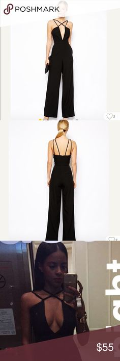 Asos jumpsuit Asos deep v jumpsuit. Size 0, but altered to fit someone who is petite. I am 5'1. DO NOT purchase if you are taller because it will not be long enough. Worn 2x. Cup size 34C. ASOS Dresses