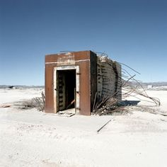 A test conducted in Nevada included a bank building and vault.  The building was obliterated, but the vault survived.   This was a near direct hit by a small nuclear bomb.  The effect would be similar to an indirect hit by a large H-bomb