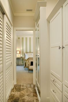 """Jacksonville, Florida Design Ideas: Mimic the master hall closet in the gentleman's bathroom with louvered bypass doors. Add a mirrored front accessory closet for kerchiefs and ties. Install a built-in """"wardrobe"""" created from standard cabinet boxes from the same cabinetry line as the vanities. Add a lock on a drawer for valuables. Design by Gabrielle Allen Accessories closet designed by William Miles Construction by Sport Nobles Construction"""