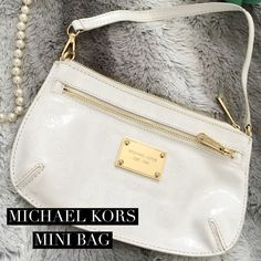 Michael Kors Mini Bag Gorgeous white & gold Michael Kors mini bag. It's a jet-set style. In amazing condition, just on the back it has a couple small black spots, shown in photo. Not very noticeable. Inside is perfect. Only worn a couple times. Gorgeous back and amazing price. 100% authentic  Michael Kors Bags Mini Bags
