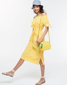 J.Crew women's off-the-shoulder tie-waist dress, reversible bucket hat, signet bag, lemon coin purse and knotted sandals.