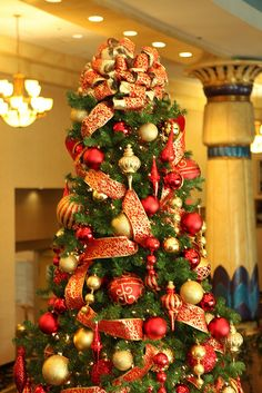 the inspiration for my tree this year! I'm making the glitter ornaments, a girlfriend is making the bow for the top!  so excited! Red And Gold Christmas Tree, Ribbon On Christmas Tree, Gold Christmas Decorations, Whimsical Christmas, Christmas Tree Toppers, Christmas Colors, Xmas Tree, Christmas Themes, Christmas Fun