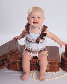 9 month baby picture idea.  Suitcase and pearls for vintage look