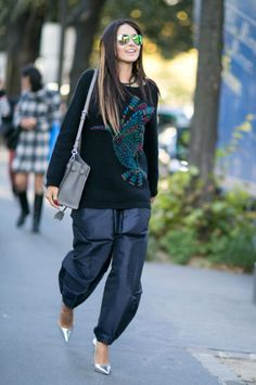 Baggy jogging pants and a comfy sweater and still fabulous. Paris Fashion Week.