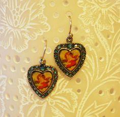 Pend. corazón con strass azul celeste y angelitos. 9,50€ REF. 121133-29