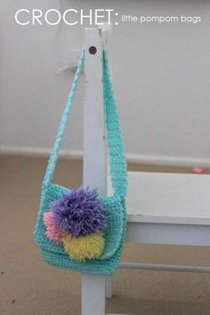 free crochet kids handbag pattern. One of my favourites! (It's the pompoms) :)